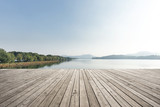 empty wooden floor with beautiful lake in blue sky - 182679593