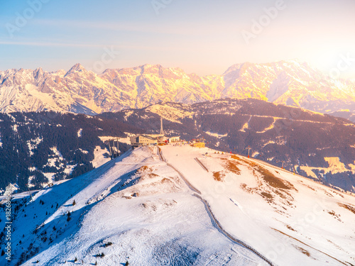 Panoramic view of winter mountains. Alpine peaks covered by snow.