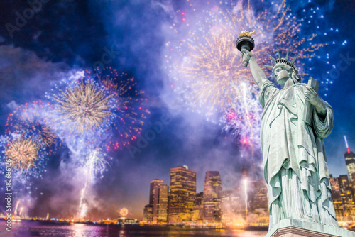 the statue of liberty with blurred background of cityscape with beautiful fireworks at night manhattan