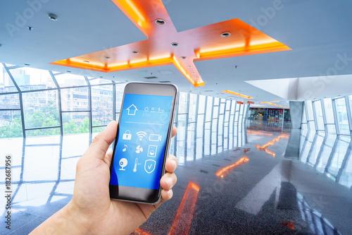 Papiers peints Kiev smart phone with smart home with modern corridor