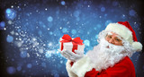Santa Claus with magic light in his hands