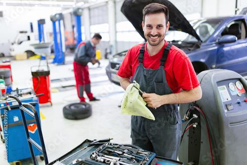 Car mechanic working at automotive service center