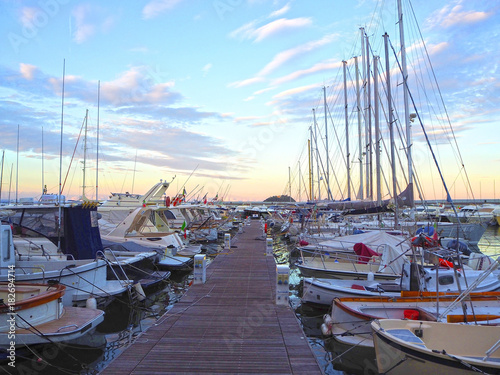 Keuken foto achterwand Liguria Luxury yachts and sailboats in seaport at sunset. Marine parking of modern motor boats in Liguria, Italia
