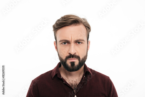 Close up portrait of frowning angry bearded man