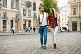 Beautiful Tourist Couple In Love Walking On Street Together.