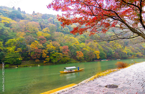 Staande foto Kyoto Wooden boat for tourist enjoy beautiful scene Autumn leaves in Japan.