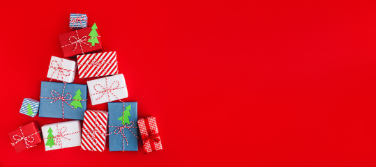 Holiday background with a christmas presents. Panorama, flat lay.