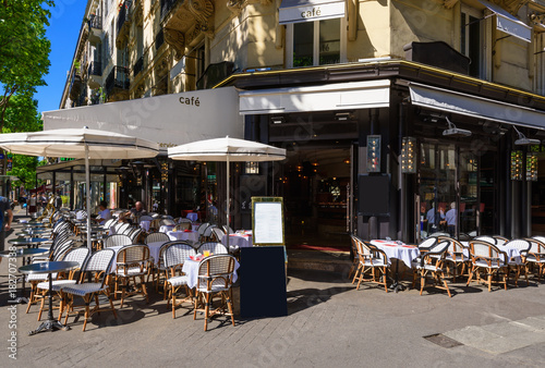 Typical view of the Parisian boulevard with tables of brasserie (cafe) in Paris, France