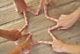 Star shape with six hand fingers on a beach - 182715108
