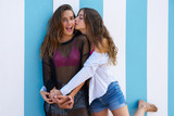 Best friends teen girls happy in summer beach - 182718125