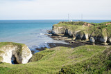 Flamborough, Yorkshire, UK. Chalk sea cliffs and a coastguard installation at Flamborough Head. - 182718940