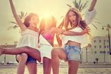 Best friends teen girls fun in a beach sunset - 182720189