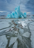 Famous Fjallsarlon glacier and lagoon with icebergs swimming on frozen water. - 182721105