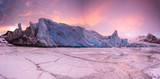 Famous Fjallsarlon glacier and lagoon with icebergs swimming on frozen water, sunset. - 182721134