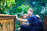 Father and preschool kid boy discovering flowers, plants and butterflies at botanic garden. - 182721716