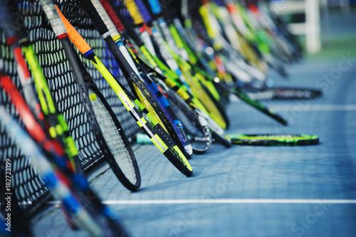 Aluminium Tennis tennis rackets or tennis racquets leaning against tennis court background