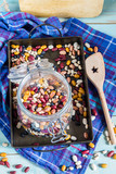 Beans mix in the jar and tray. Blue wooden table and background. - 182724116