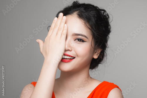 Fashion portrait of asian woman with elegant hairstyle. Perfect makeup.