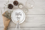Dinner plate setting on wood table top view. - 182726935