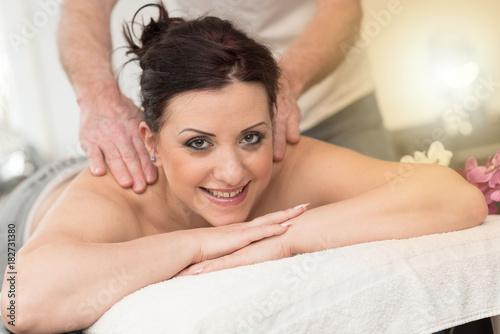 Fotobehang Spa Beautiful young woman getting massage, light effect