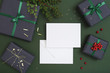 Christmas paper sheet card on dark green background, card with envelope, letter to santa