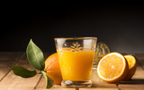 Glass with orange juice on the wooden table - 182733148