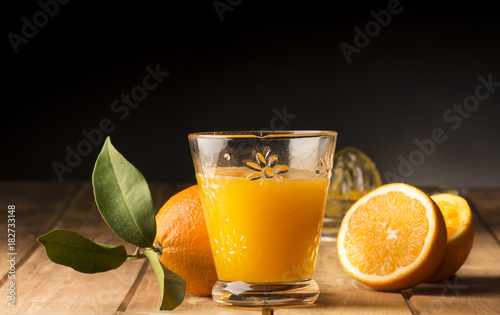 Sticker Glass with orange juice on the wooden table