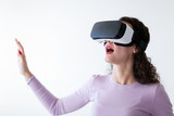 Young excited woman trying virtual reality headset