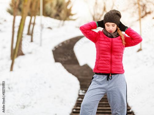 Sticker Woman wearing sportswear exercising outside during winter