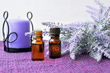 Bottles of essential lavender oil with candle - 182752306