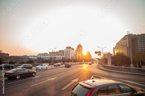 Aluminium Peking Sunrise in China with cars on the street