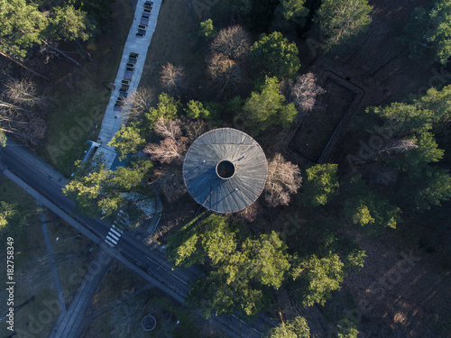 Aerial top down view over old water tower in Druskininkai outdoor park, Lithuania.