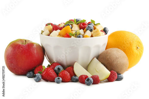 Fresh fruit salad in bowl isolated on white