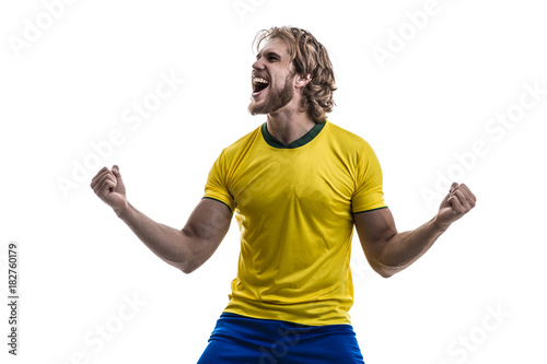 Fotobehang Voetbal Male athlete / fan in yellow uniform celebrating on white background