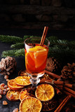 glass of hot mulled wine with oranges and spices. - 182761302