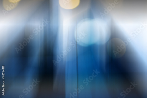 Abstract business modern city urban futuristic architecture background. Real estate concept, motion blur, reflection in glass of high rise skyscraper facade, toned blue picture with bokeh - 182764519
