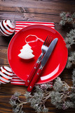 Red plate, knife and fork, napkin and christmas decorations - 182787940