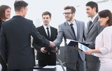 handshake of business partners before the financial transaction - 182796715