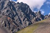 mountain clouds rock peak slope