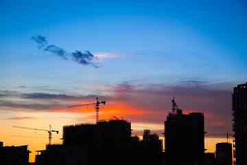 Silhouette of city construction Site at sunset