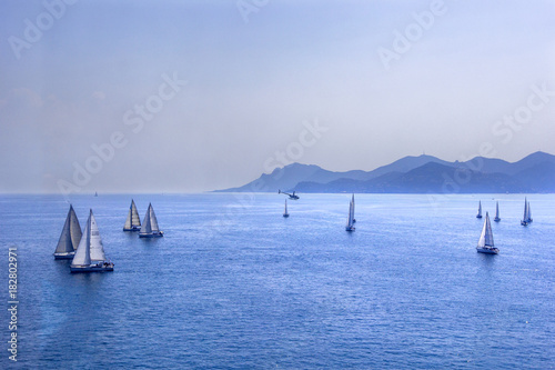 Sailing regatta or a group of small water racing boats in the Mediterranean, a p Poster