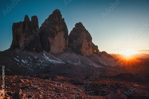 Wall mural Tre Cime di Lavaredo at sunset in the Dolomites in Italy, Europe