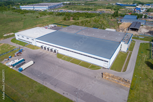 Fototapeta aerial view warehouse building on a summer day