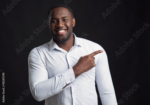 Plakát African american man shows a finger in the right. Smiling face.