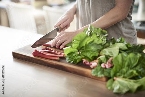 Sticker preparing a rhubarbpie in a platter