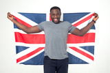 Handsome afro american man with Great Britain flag in hands. Smiling face. Successful confident patriotic male. Learning English - concept. - 182819976