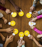 Group of children branstorming and sharing ideas with light bulb - 182822938