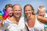A Caucasian family is enjoying summer vacation - 182825735