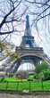 Skyward view of Eiffel Tower on a cloudy winter day - France