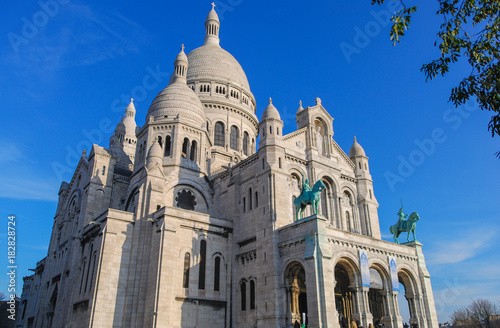 Sacré Coeur cathedral white facade front with deep blue sky above, Paris, France Poster